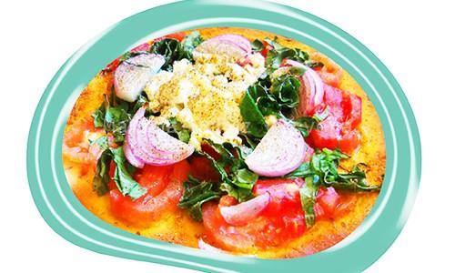 Pizza vegetal con queso ricotta.