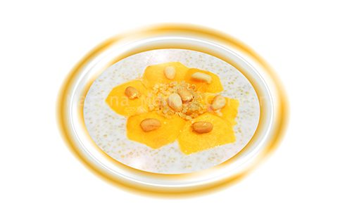 Yogur descremado con quinoa y melocotón.