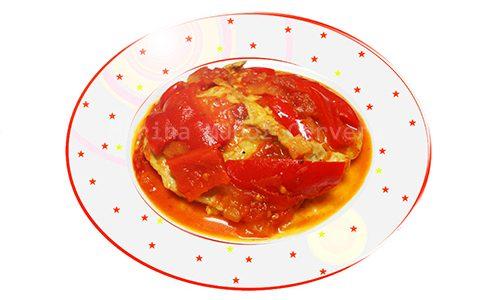 Lomo de cerdo con pimientos rojos.
